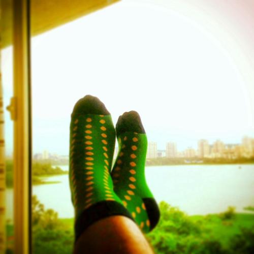 Green socks with yellow detailing, @dezinedemon / Shaizad Charanya