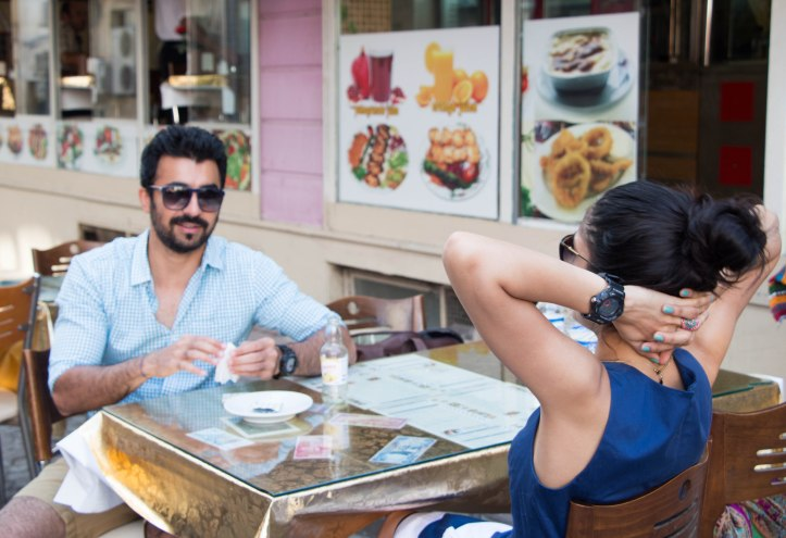 Making that Doner pit stop to boost energy levels. On Manoj Kr : Shades by Armani, Watch by G Shock, Shirt by Kotton