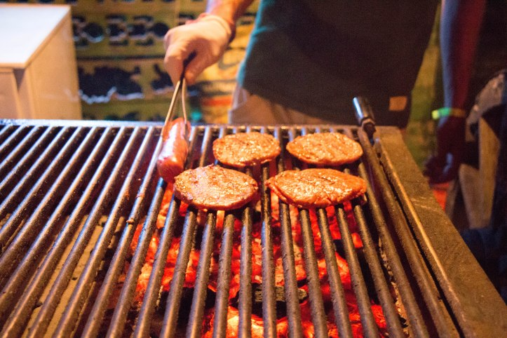 Those juicy burgers being grilled fresh.